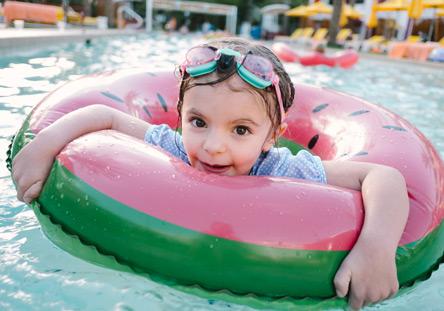 kid in pool on floaty