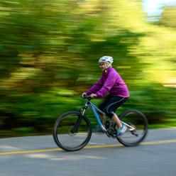 woman riding bike on road